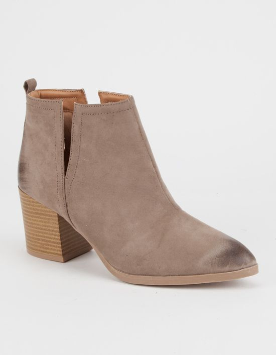Features a faux suede upper with v-slit cutouts at the sides. Tab at the  back of the heel. Rubber outsole with a stacked wooden heel.