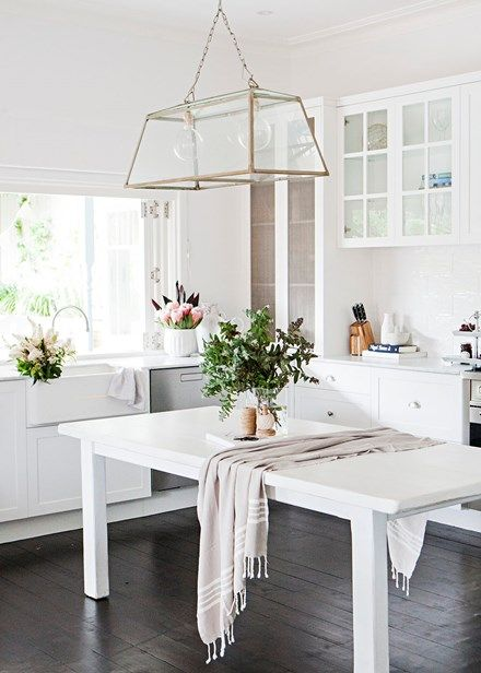 This kitchen's simple palette, grounded by dark-stained timber floors, is a lesson in timeless design