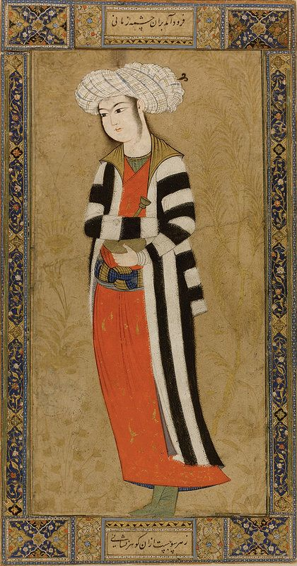 جوان با صراحی، اصفهان، در اوایل قرن 17 میلادی، گواش، آبرنگ، با طلا بر روی کاغذ، نقاشی: 18.5 در 9.3 سانتیمتر برگ: 22.3 در 11.8 سانتیمتر A YOUTH IN A STRIPED COAT, PERSIA, ISFAHAN, EARLY 17TH CENTURY Gouache heightened with gold on paper, depicting a beturbaned youth standing in a striped robe, holding a tall-necked bottle, surrounded by tall leafy shrubs in gold, laid down on card with applied borders decorated with polychrome scrolling flowers painting: 18.5 by 9.3cm. leaf: 22.3 by 11.8cm.