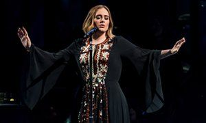 Gripping and dramatic … Adele headlines the Pyramid stage at Glastonbury.
