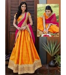 Buy Orange and golden embroidered unstitched bridal lehengas Online