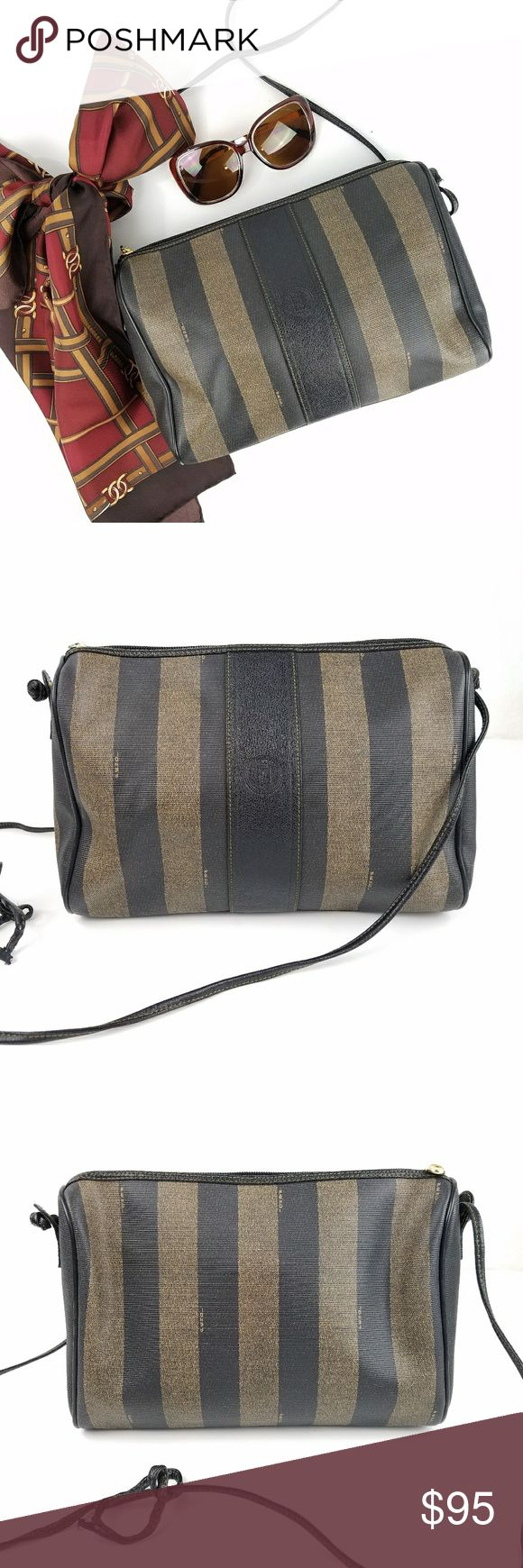 "Vintage Fendi Penguin Striped Shoulder Bag Made in Italy Classic penguin stripe with Fendi print throughout Zip top closure with logo zipper pull  1 interior zipper wall pocket Lining is super clean Serial number visible 11.25"" x 9"" 56"" long shoulder/crossbody strap Excellent vintage condition - shoulder strap is torn, but can be tied in a knot to not be visible   PLEASE READ CLOSET INFO AND POLICIES POST Fendi Bags Crossbody Bags"