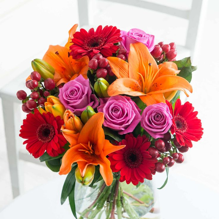 Autumn Dazzle: An exquisite blend of orange, red and pink tones that characterise Autumn. Dazzle someone special today with this striking bouquet.