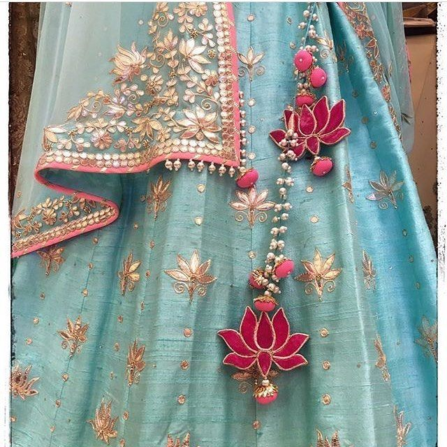 Look at these lotus tassels  floating over an aqua #lehenga .. So so pretty  : Swati Ubroi  Spotted beauty at @bridalasia ! #exhibition #bridalasia2016 #lehenga #pretty #pink #aqua #lotus #tassels #gota
