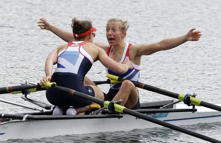 Great Britain's Katherine Copeland, left, and Sophie Hosking celebrate after winning the gold medal for the lightweight women's rowing double sculls in Eton Dorney, near Windsor, at the 2012 Summer Olympics, Saturday, Aug. 4, 2012. (Photo credit: AP Photo/Chris Carlson)