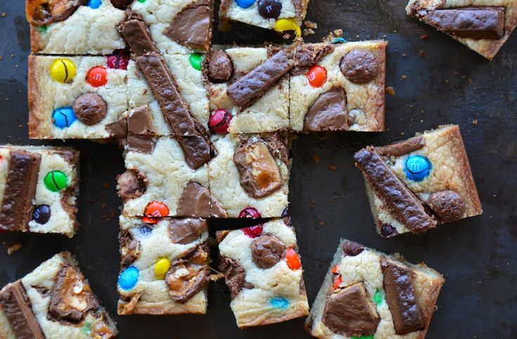 Turn leftover Halloween candy into a freshly baked dessert with a recipe for Leftover Halloween Candy Blondies.