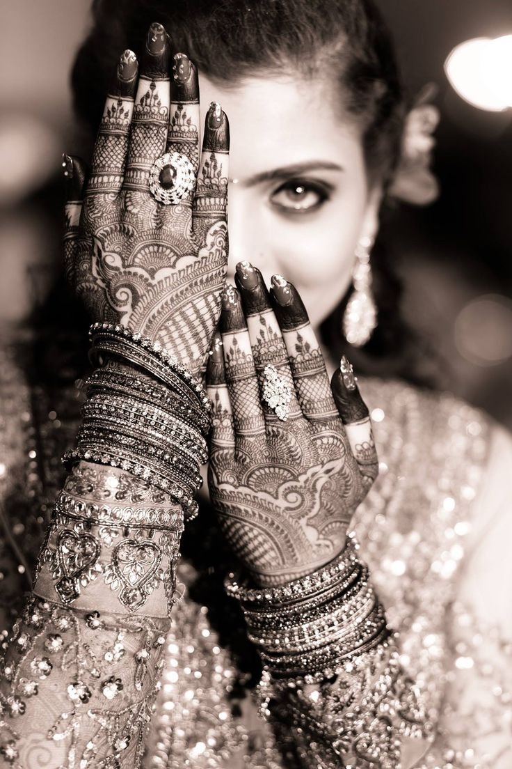 Indian weddings are traditionally multi-day affairs, and involve many intricate ceremonies, such as the painting of the hands and feet of the bride called a mehndi.  http://www.nmpudhyog.com/