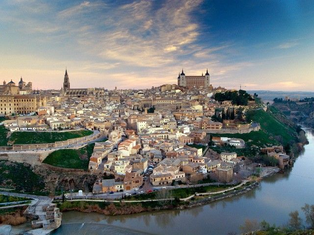 Toledo, Spain... unique and beautiful with an array of architectural styles. Just south of Madrid...we took the train there for a day trip of roaming and it was perfect.