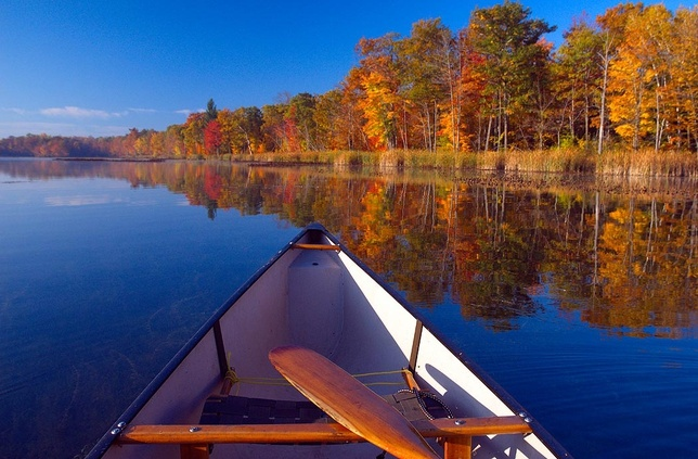 canoe on a lake in the fall photo