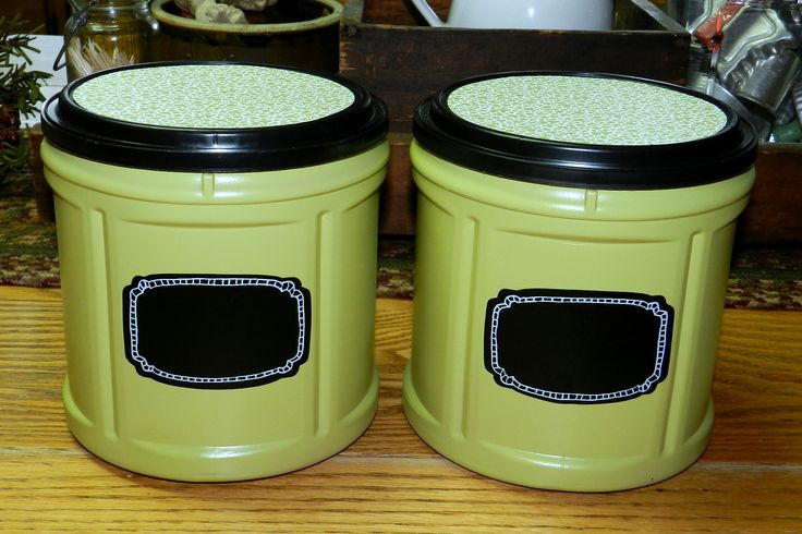 Repurposed Folgers coffee cans - spray paint + scrapbook paper + chalk board labels = new canisters!