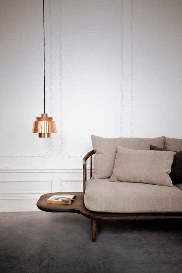 copper accent light and neutral sofa