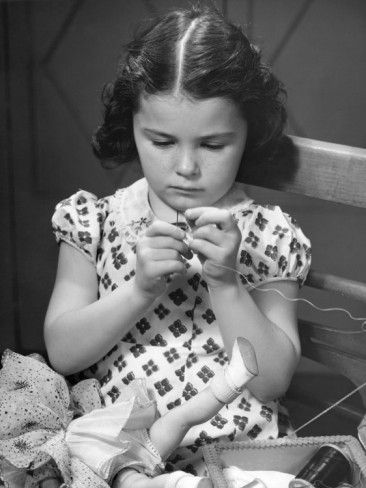 Girl Sewing Clothes For Doll Photographic Print by George Marks at AllPosters.com