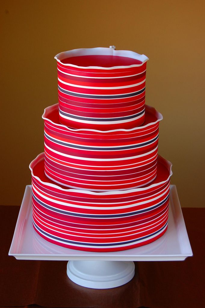 Wow...what a cake! That color is striped modeling chocolate, not fondant...yowza!
