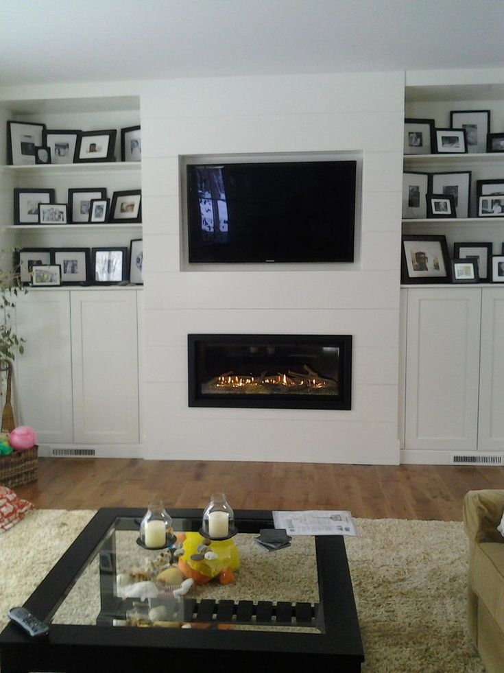 fireplace and TV with ship lap