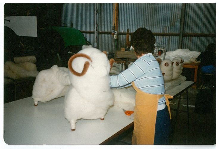A photograph from the archives. The construction of large woollen sheep, often used for displays in the stores.