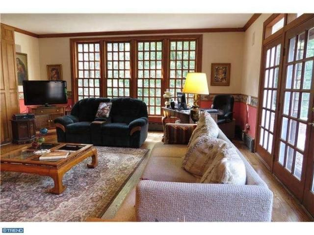 DOYLESTOWN – 5635 Point Pleasant Pike. Bucks County farmhouse. Tree-lined driveway with apple trees. Hardwood floors, carved fireplace mantel, crown molding, chair rail, 6/6 windows, paneled doors, deep windowsills, 2 sets of pie stairs. Kitchen with center island. Family room with 2-sided fireplace, 2 walls of windows, built-in entertainment cabinet. Second level with 4 bedrooms. Master suite with wood stove, private bath, double vanity, commode, bidet, Whirlpool tub, stall shower.