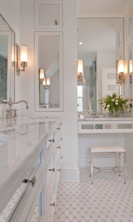 Luxury White Bathroom - Elegant floor tiles compliment the mirror cabinet drawers. The bathroom should reflect your beauty!