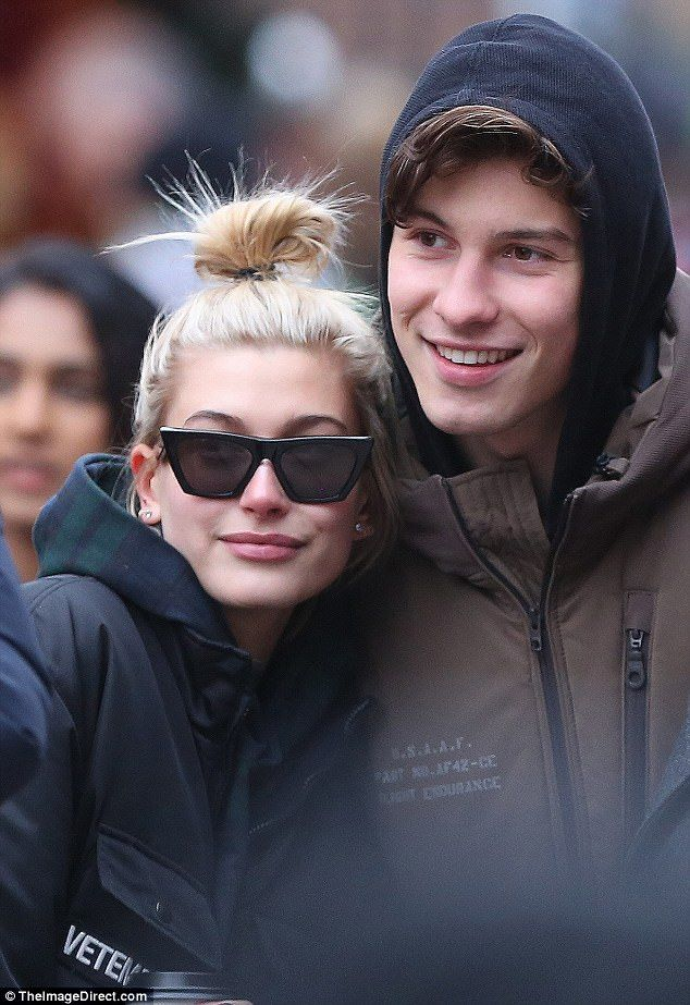 The smile that says they're in love: Hailey Baldwin and Shawn Mendes were spotted hugging as she visited him in his hometown of Canada on Thursday