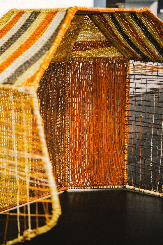 We thought it would be great to showcase the ongoing work we do with the weavers of Elcho Island by having them weave their traditional materials onto a wire version of Koskela's Hoodie.