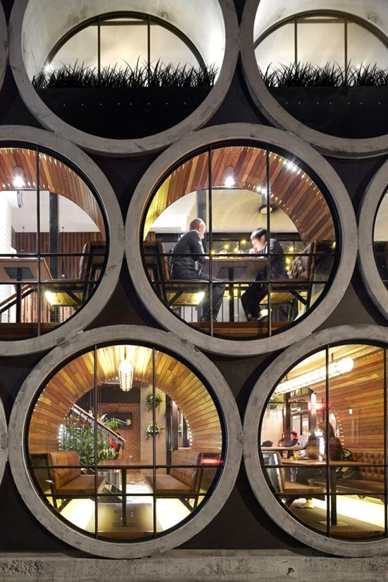 Seventeen oversized concrete pipes stacked over each other create the façade of the Prahran Hotel bar in Melbourne. Designed by Australian architecture studio Techne