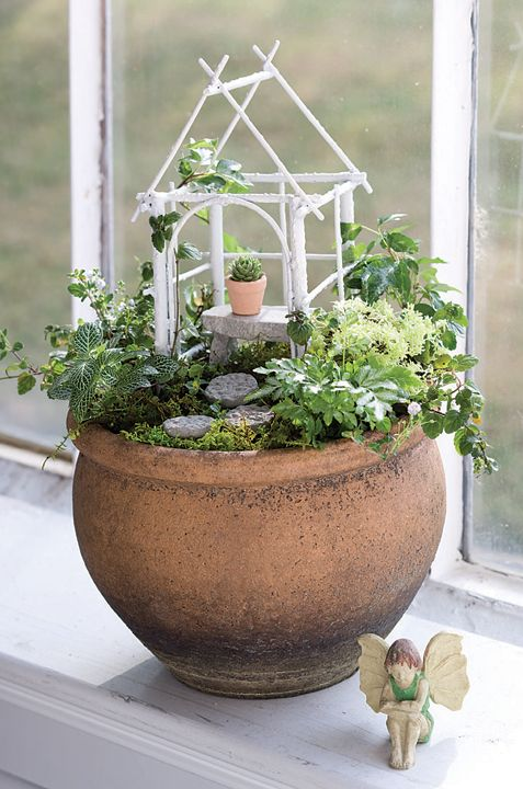 Jeremie | Miniature garden container with white arbor, cement bench, stones, tiny pot and fairy.