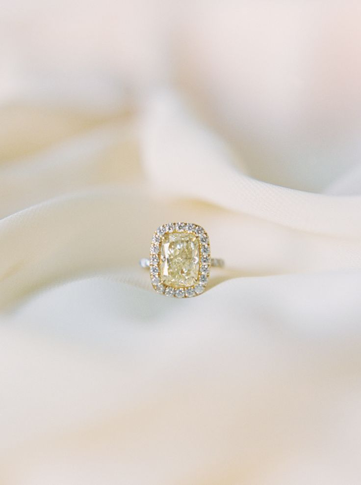 Um... we're in love! Photography : Apryl Ann Photography Read More on SMP: http://www.stylemepretty.com/2016/05/25/canary-yellow-diamond-engagement-ring/