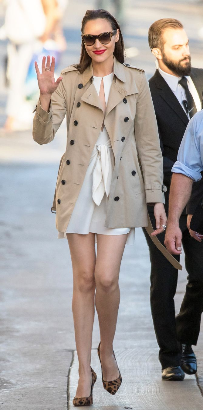 Gal Gadot in a white mini dress and short trench coat - click through for more celebrity coats