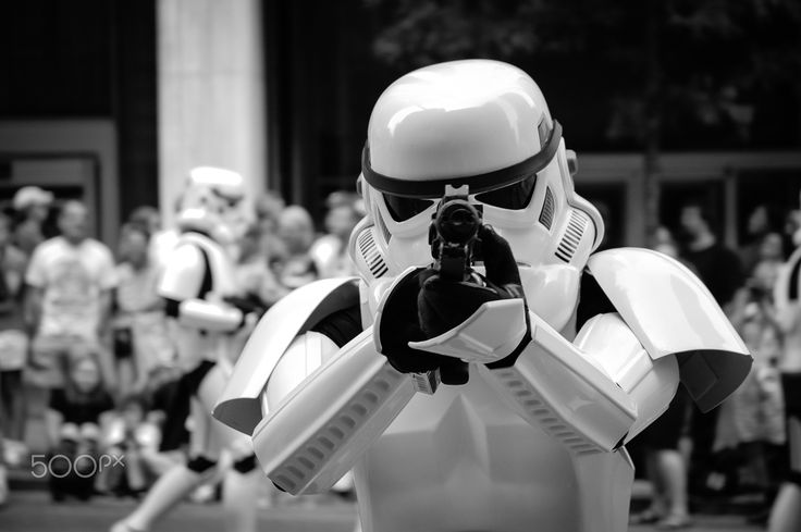 Stormtrooper pointing with his gun - Stormtrooper pointing at the camera with his gun during the Dragon Con Parade in Atlanta, United States in 2007