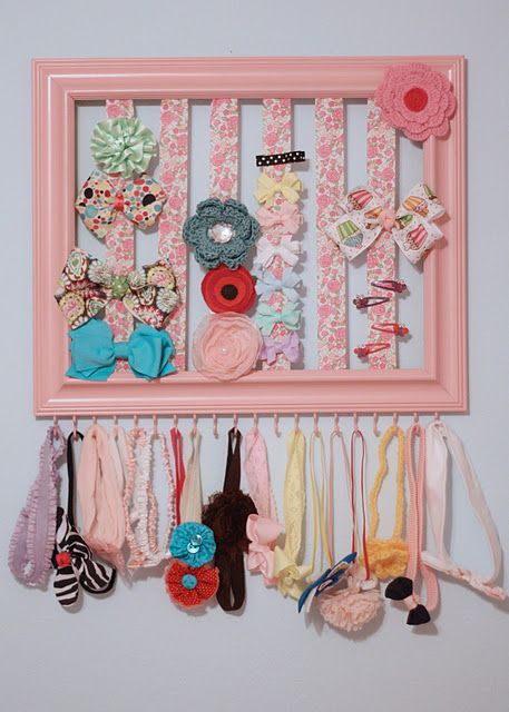 Add some ribbon, hooks and paint to a regular old picture frame and you've got a bow/clip holder AND headbands too!! Genius- now, should I make one big one, or a few 5x7s? Cuteness!