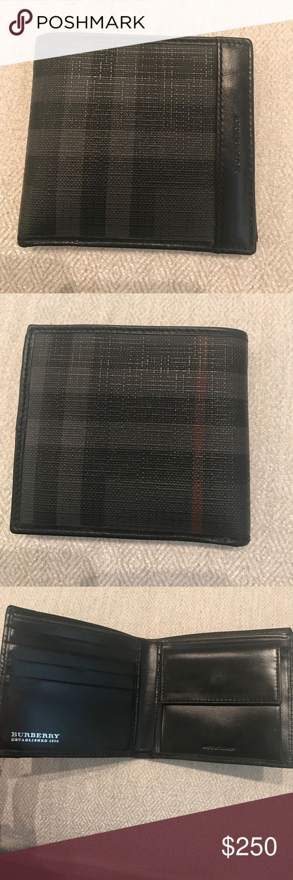 Men's Burberry check wallet Men's Burberry flap check wallet in excellent condition, minor wear from minimal use. 4 card slots, 3 additional slots for cards or money, one long compartment for money, and buttoned change pouch. When closed 4 inches by 4 inches. Burberry Bags Wallets