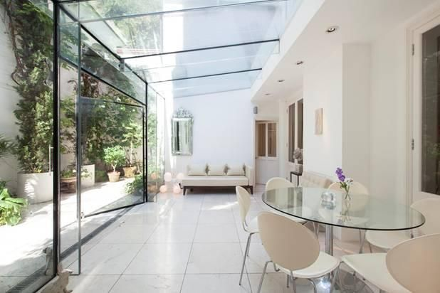 Glass roof and outward opening doors