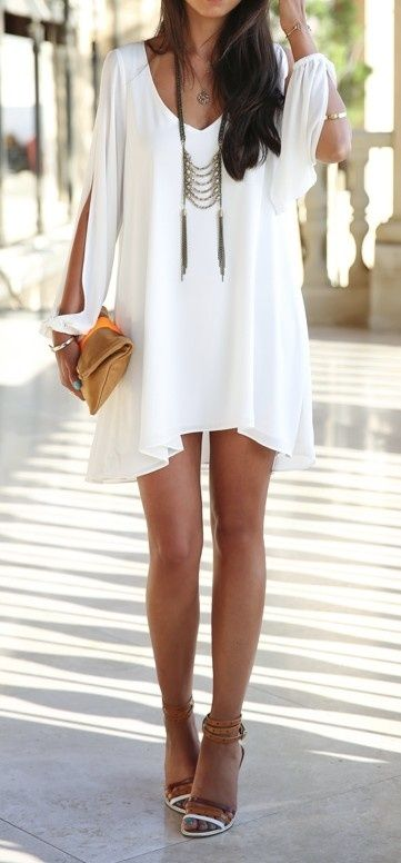 long flowy hippie white dress, brown sandals with heel, long indian style necklace, rustic clutch. perfect outfit