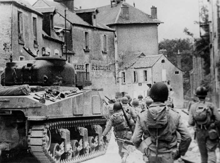 July 18,  1944: US TROOP MARCH INTO ST. LO.  -    American forces in France capture the Normandy town of St. Lo.
