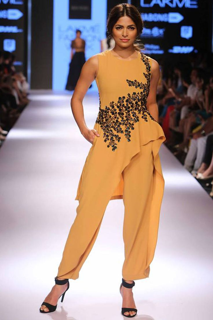 Mustard and black sequins embroidered high low cape jumpsuit available only at Pernia's Pop Up Shop.#lakmefashionweek #ridhimehra #ramp #clothing #designer