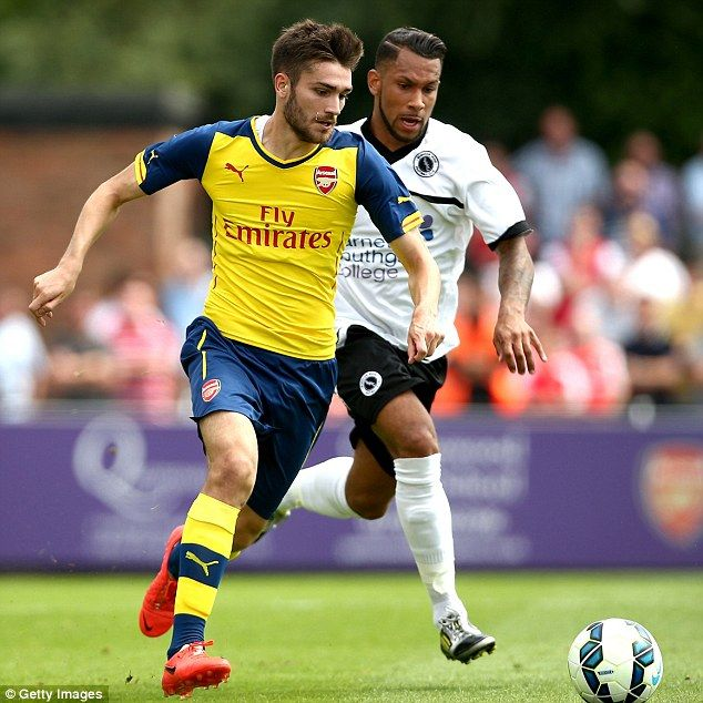Battle: Jon Toral of Arsenal fights for the ball with Boreham Wood's Greg Morgan during th...