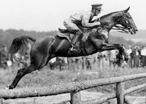 Portuguese Olympic horse rider José Beltrão and his horse Biscuit in 1936