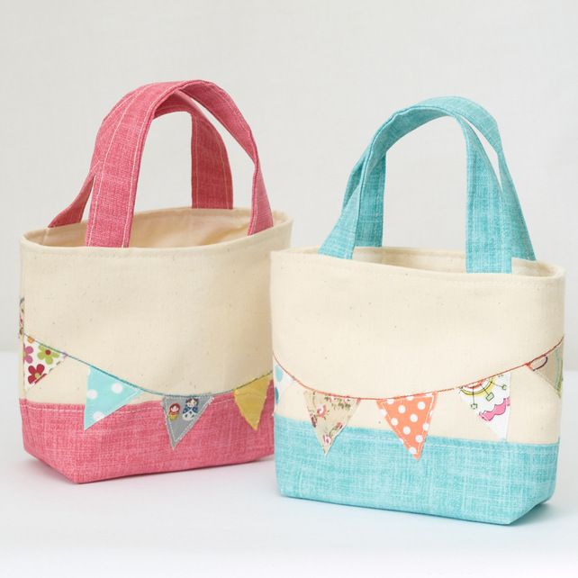 Toddler tote bags.  Love the pink colouring, and the overlayed bunting