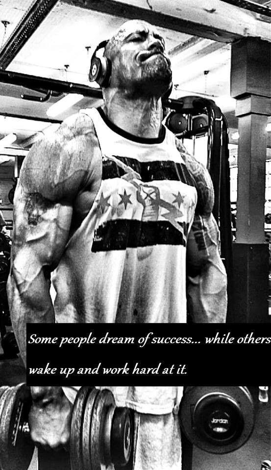 Dwayne The Rock Johnson (wearing A CM Punk Shirt)