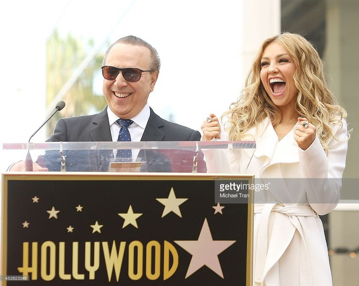 Tommy Mottola (L) and Thalia attend the ceremony honoring her with a Star on The Hollywood Walk of Fame held on December 5, 2013 in Hollywood, California.