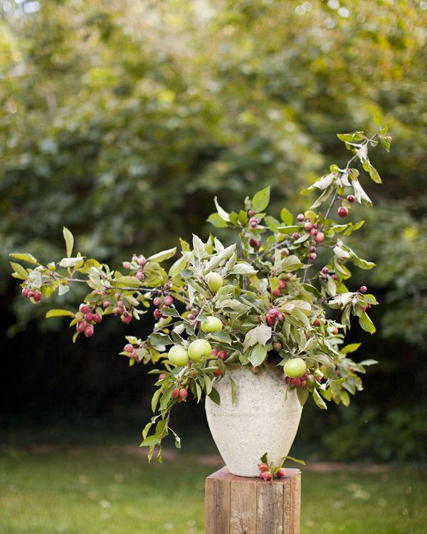 Foliage branch centerpieces bouquet flowers crab apples