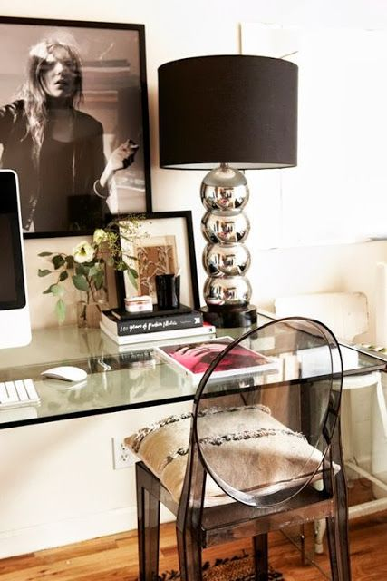 STYLE LOGISTICS: 8 Glamorous Home Office Spaces   Obsessed with Lucite chairs like this one - add a cute pillow for comfort but most importantly add one that expressed your personal style!