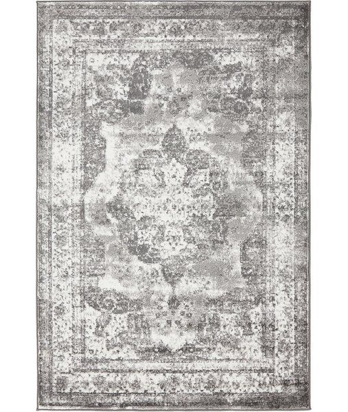 Add an antiqued touch to the foyer or anchor your dining room ensemble with this timeless rug, showcasing an elegant Persian-inspired motif.