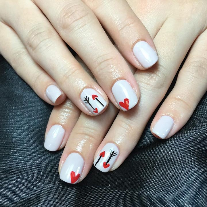 ivory nails with valentines heart design