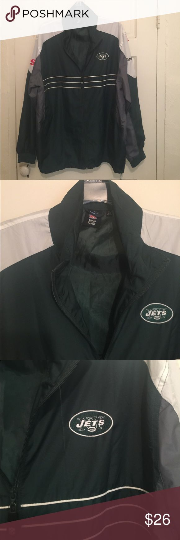 "REEBOK NFL NY JETS SI JACKET, WINDBREAKER SIZE -XL MEN'S REEBOK NFL NY JETS SI JACKET, WINDBREAKER SIZE -XL  Color: Green,Gray,White Full Zip As Well As Draw String Closure At Hem. Ribbed cuffs not just elastic sewn into a hem like the newer ones. It has the NY Jets embroidered patch sewn into the upper left chest.""  100% Polyester 100% Polyester Lining Measurements Where Taken With Jacket Laying Flat: Size- XL  Armpit To Armpit : 26.5"" Length From Shoulder To Hem : 30.5"" Sleeve Length…"