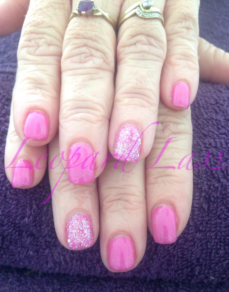 Gel polish over natural nails. Medium pink with iridescent glitter
