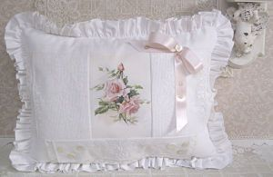 White lace pillow with pink roses