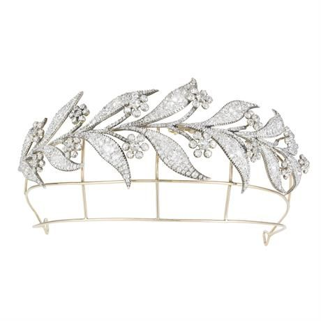 An Important Georgian diamond tiara, in the form of a garland spray of leaves and floral clusters, pave-set throughout with old-cut diamonds, weighing ~ 45 carats, cutdown collet-set in silver to a yellow gold mount, convertible to two brooches, circa 1800. As worn in Downton Abbey.