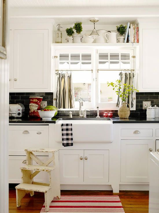 White Kitchen Red Floors Corner Pantry