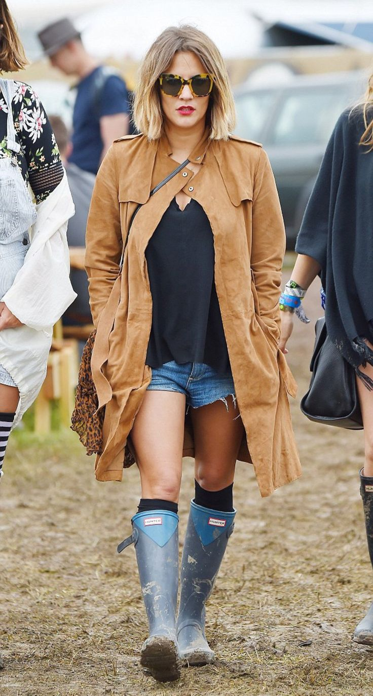 Alternative Waterproof Shoes For Your Festival Look - Festival Chick Denim Ripped Shorts Camel Trench Coat And Blue Wellies