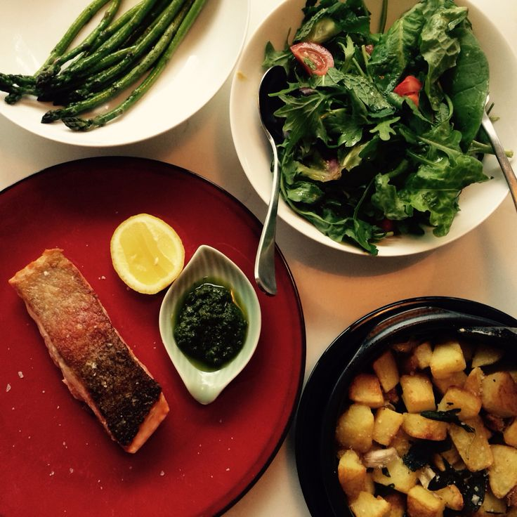 Crispy skinned ocean trout with herb salad, potatoes, grilled asparagus and chermoula